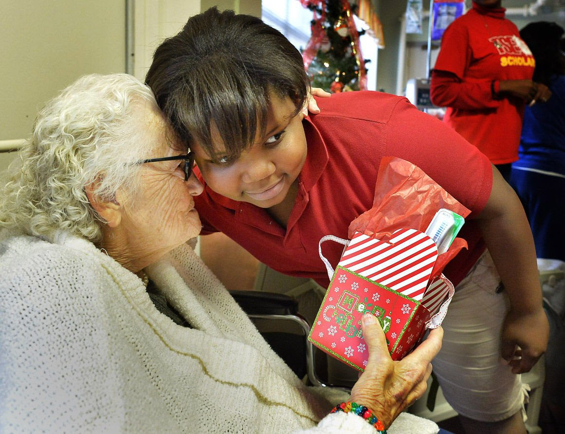 students from tenth street elementary donated christmas gifts to residents at beckwood manor nursing home in anniston left is resident ethel shaddix giving
