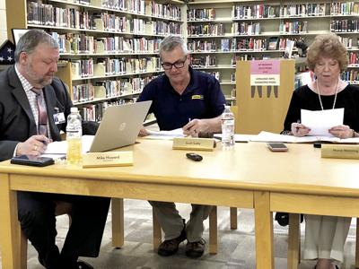 Superintendent Mike Howard and board members Scott Suttle and Marie Manning