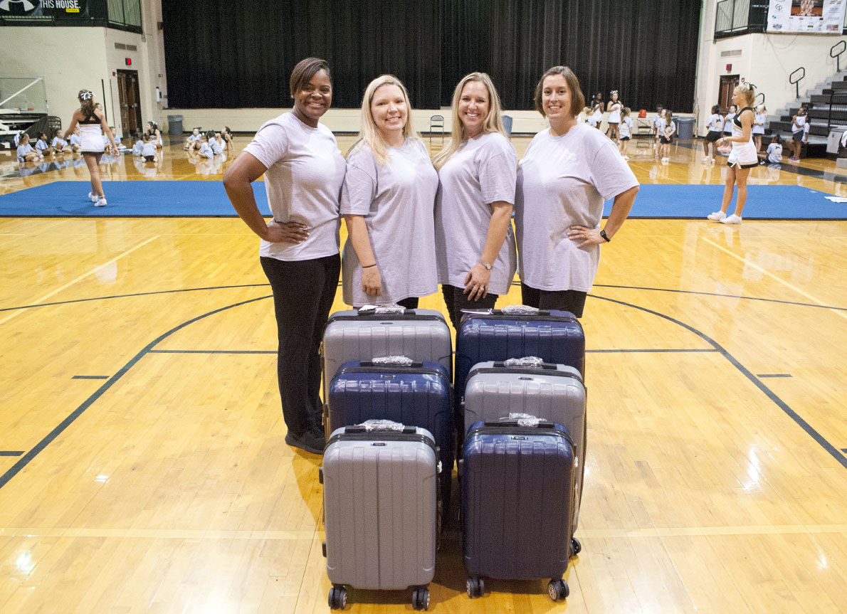 Pell City youth cheer group donates to 'Lighten the Load' for foster children