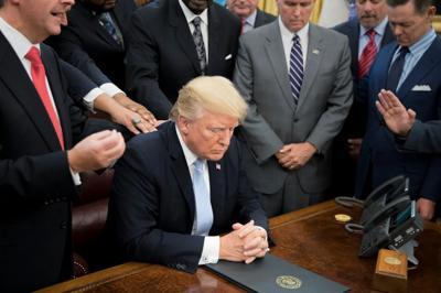 Trump praying