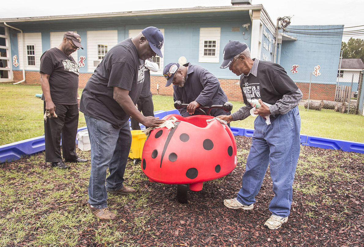 100 Men Community Support Group cleans playground equipment at Eastside Head Start