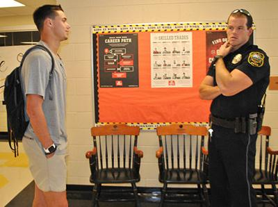Pell City High School senior talks with SRO