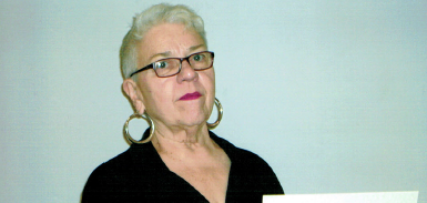 Nancy Lehe with facsimile check