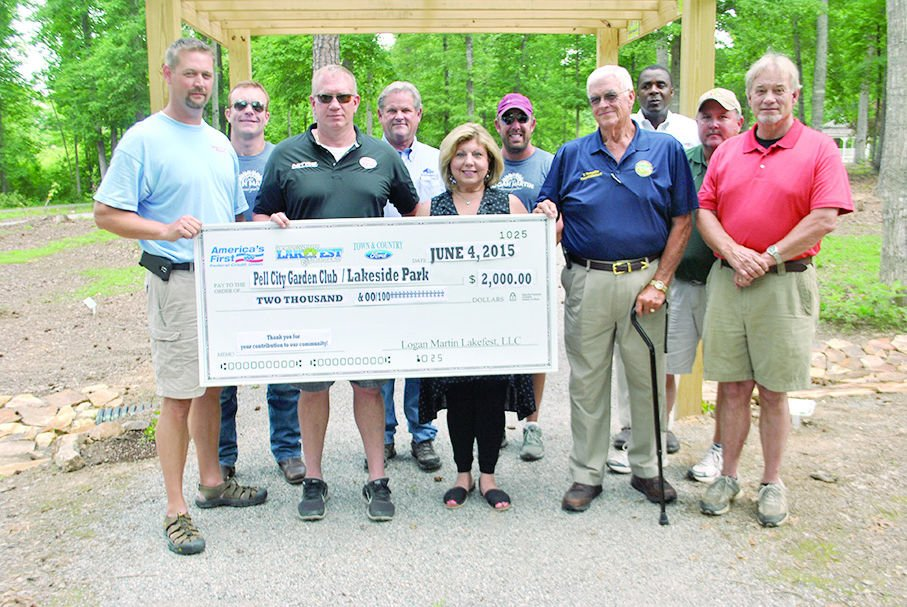 Lakefest Organizers Sponsors Hand Out Checks To 9