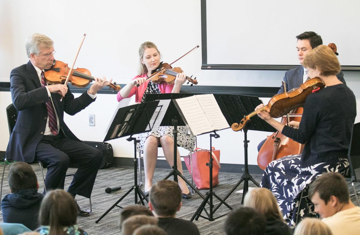 SAMFORD STRING QUARTET: Group performs for audience that includes Kennedy Elementary School 4th-graders at Pell City Public Library