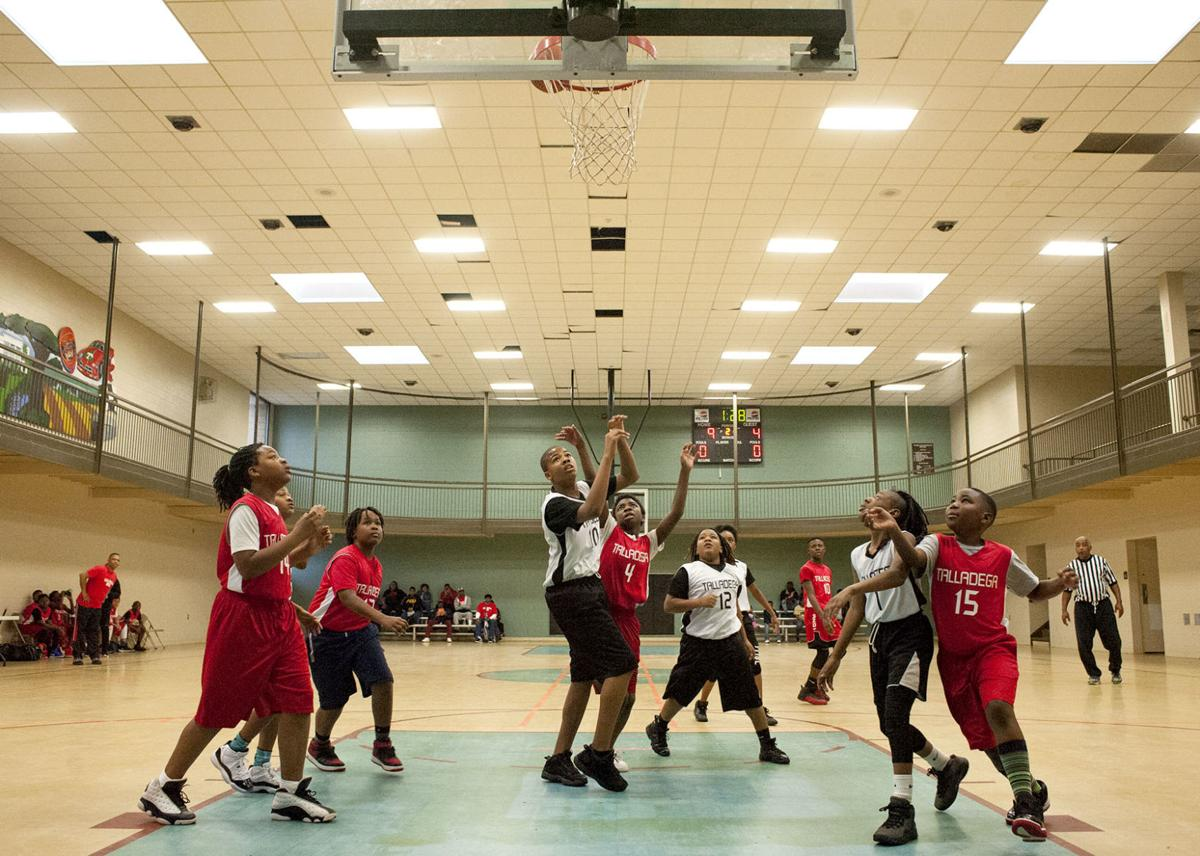 Miserable weather day not enough to keep young basketball players away from Spring Street Recreation Center