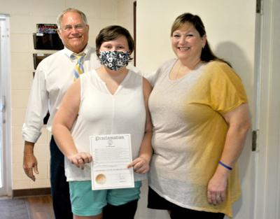 Riverside Mayor Rusty Jessup presents proclamation to cancer patient Mileena Painter
