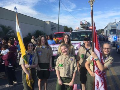 In Your Community ... Girl Scouts march in Veterans Day parade