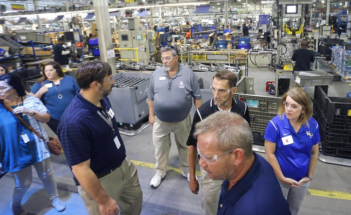 Local industry tour shows educators potential manufacturing jobs for students