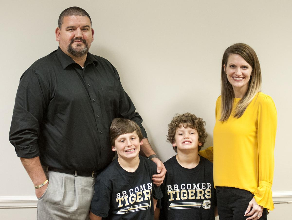 New B.B. Comer football coach and family