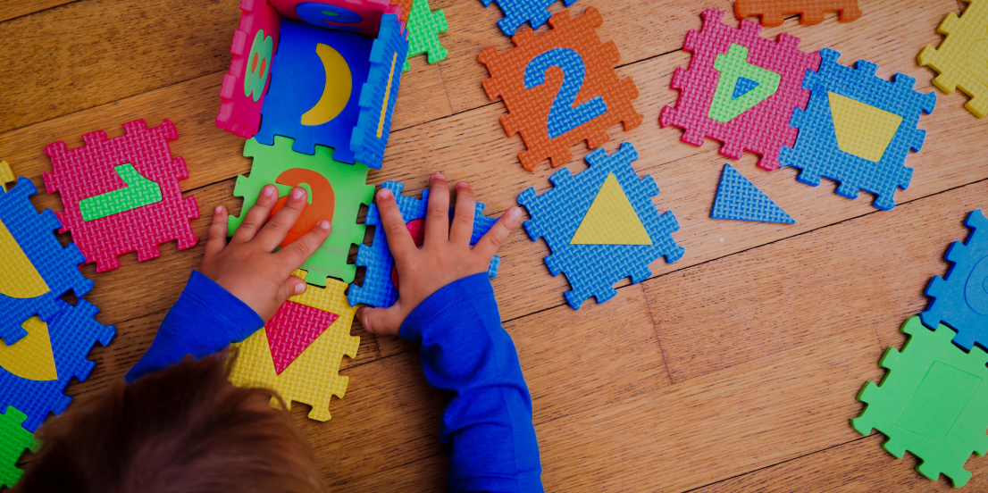 Child working puzzle
