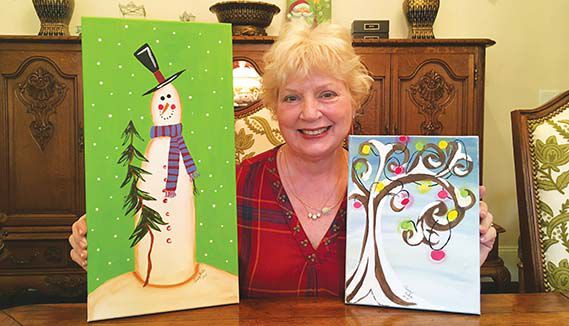 Penny Welch creates art on Christmas balls