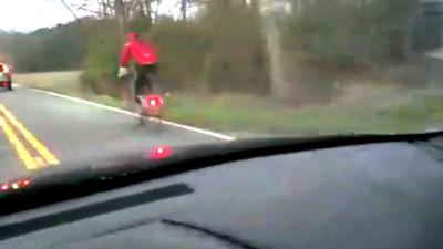 Motorist charged after posting anti-cycling videos