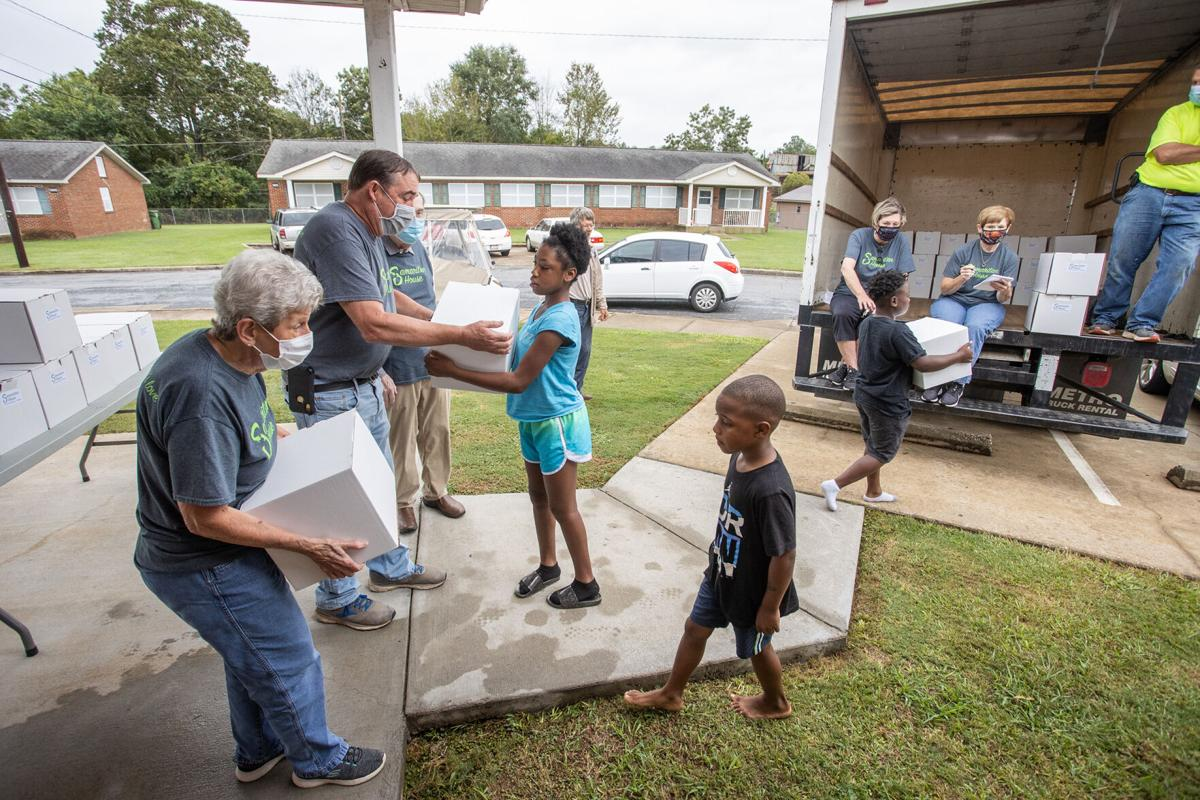 Samaritan House delivers boxes of food to residents of Knoxville Homes Community (with photo gallery)