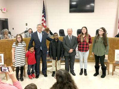 Talladega City school board recognizes art contest winners