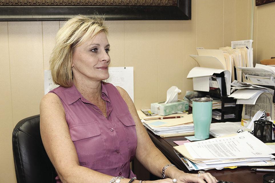 Adrianne Dodgen checks on students