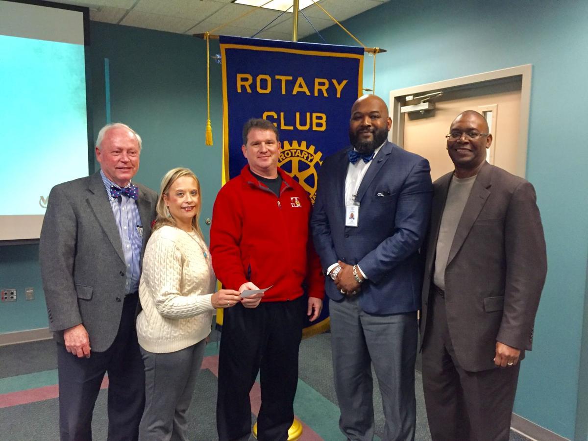 Talladega Rotary presents check to Talladega City Schools officials