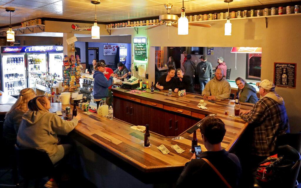 Virus Outbreak Wisconsin Bars Open