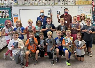 Third-graders get dictionaries from Rotarians