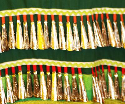 Bells on a female dancer's Jingle Dress