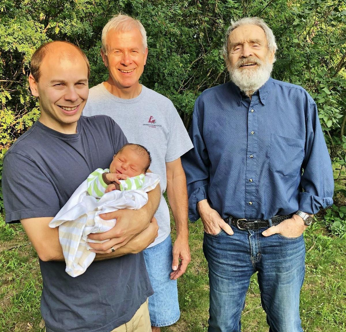 Newborn Samuel Hardie is held by his father, Ross, alongside grandfather Chris Hardie and great-grandfather Bob Hardie..jpg
