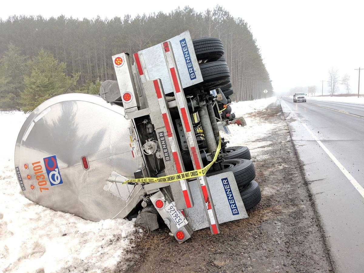 Tanker truck in the ditch on its side