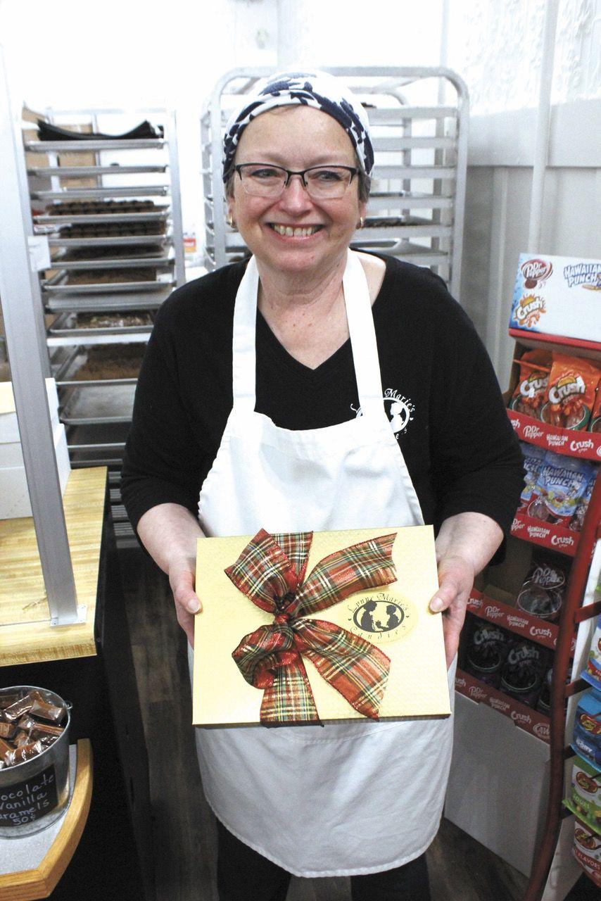 12-11 Lynn Marie's Candies, Lynn Marie with gift package.jpg