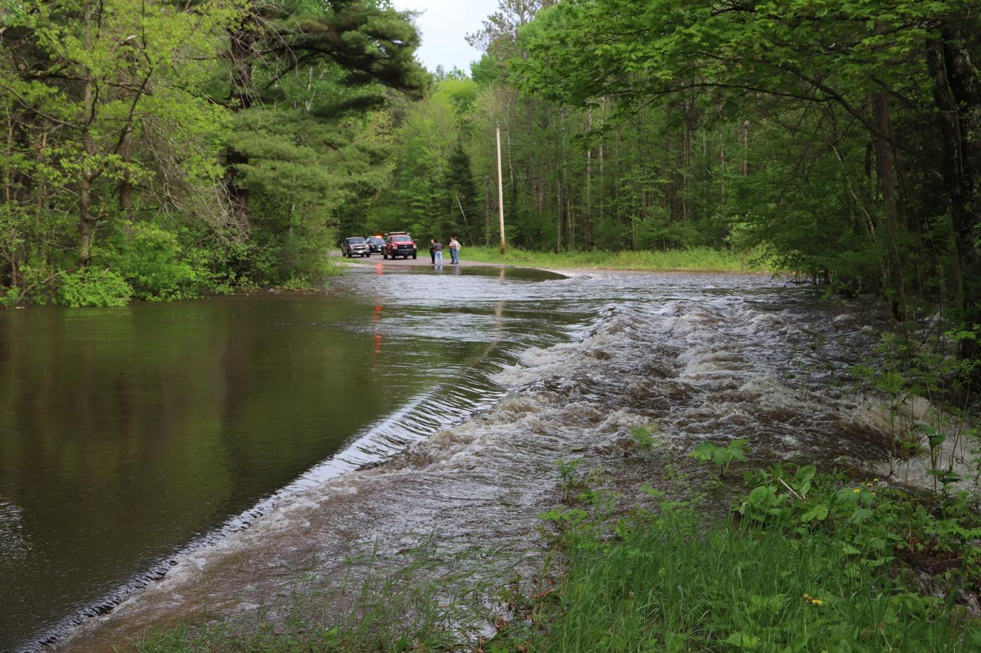 Flood overtops Mosquito Brook Road