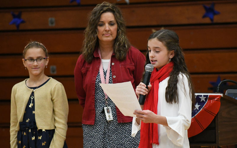 fourth graders recite veterans day essays apg wi com fourth grader lola olsen recites her essay on ldquowhat veterans day means to merdquo as helen thompson left waits to her essay and hayward elementary campus