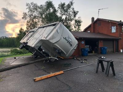 Camper on house from storm
