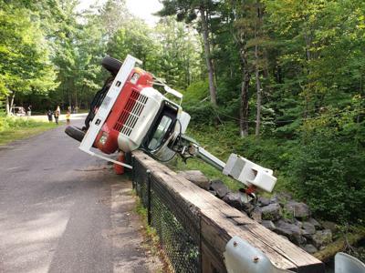 Utility truck overturns