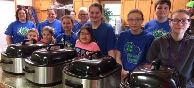 Kids from Cameron serve breakfast