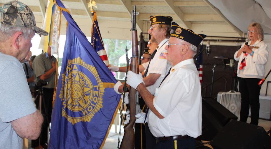 Veteran receives a Quilt of Valor during Bluegrass Fest