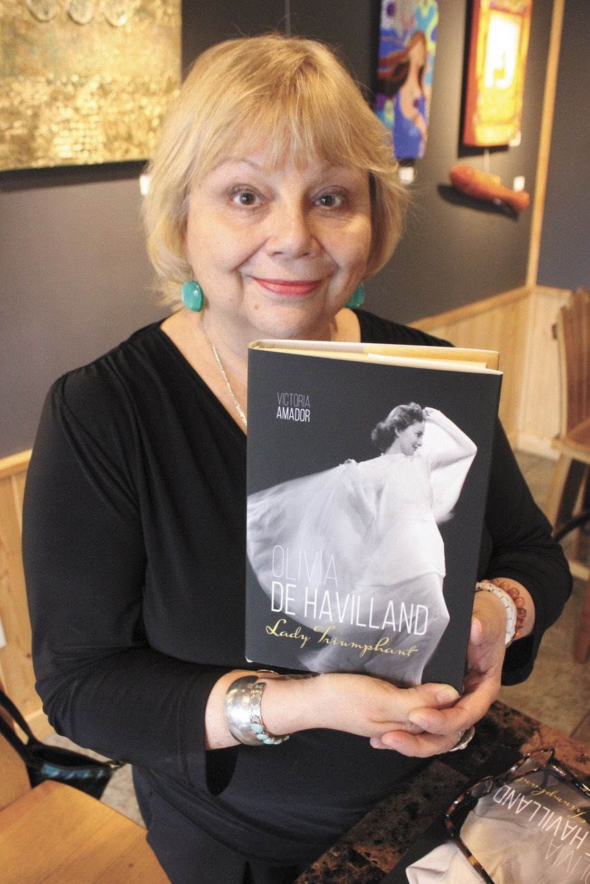 Olivia De Havilland, author with book.jpg