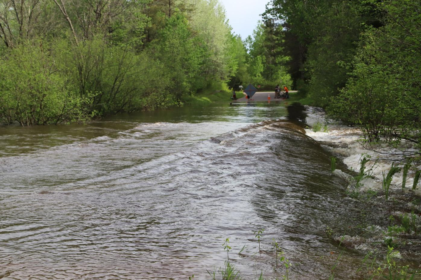 Mosquito Brook flash flood covers road