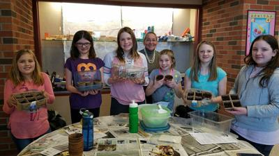 Girl Scouts plant marigolds