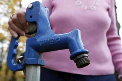 Well water pump spigot