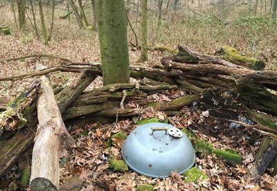 Chris Hardie's ground stand includes an old grill he uses for a wood fire..jpg