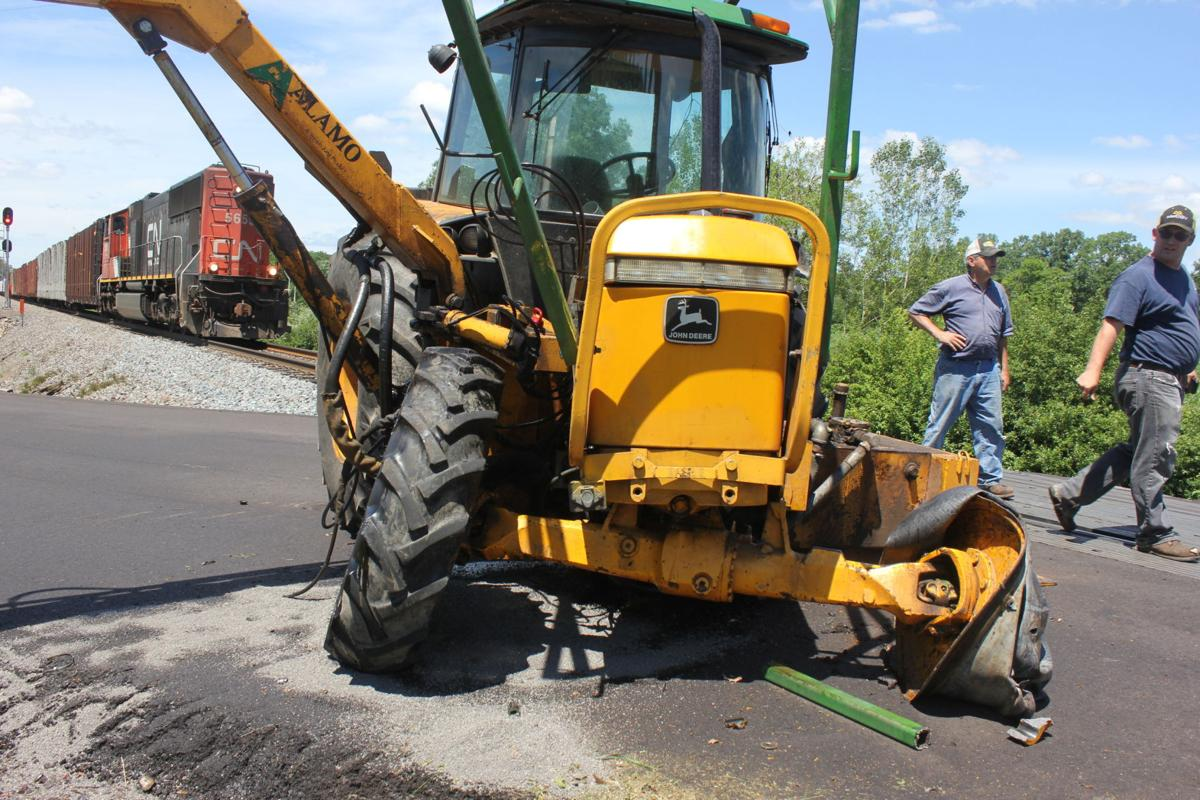 Train hits tractor mower on Metcalf Road in Washburn County