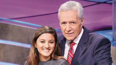 Lauren D'Souza with Jeopardy host Alex Trebek.