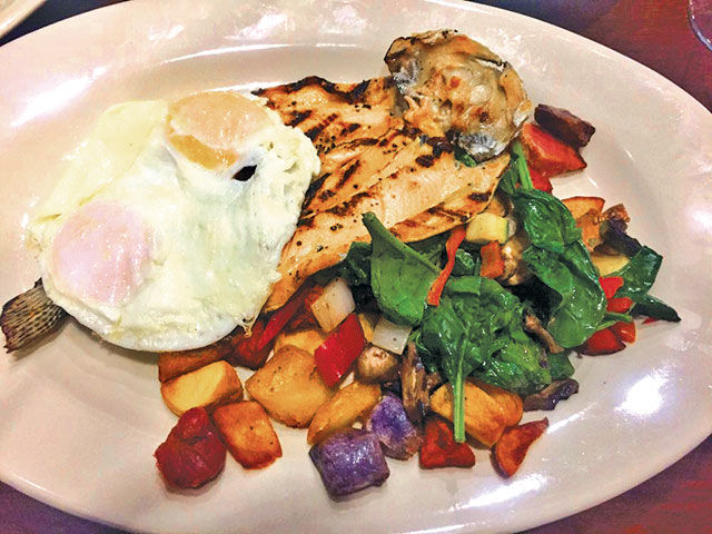 Rainbow Trout entrée over vegetables with tri-colored home fries.