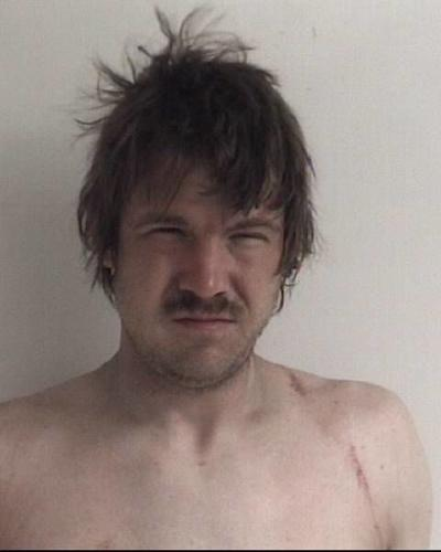 Owosso man charged after threatening to kill people with sword