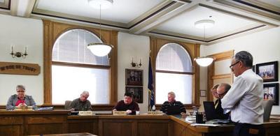 Judge seeks compensation for employee handling two jobs
