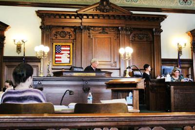 Woman who used late boyfriend's funds on trial