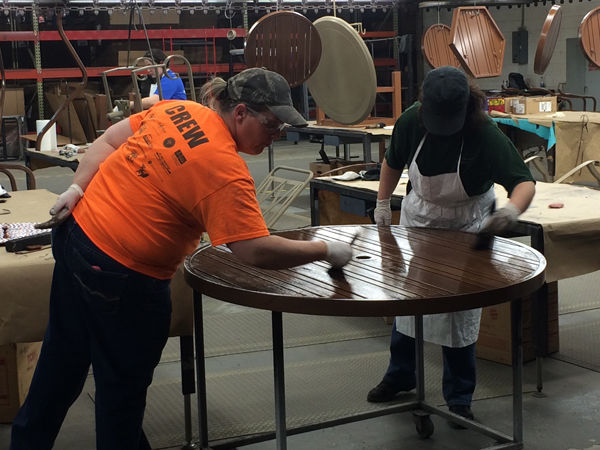 Woodard Furniture Employees Paint A Table At The Woodard Factory In Owosso.  The Company Employs Around 180 Employees, Most Of Whom Are From The  Community.