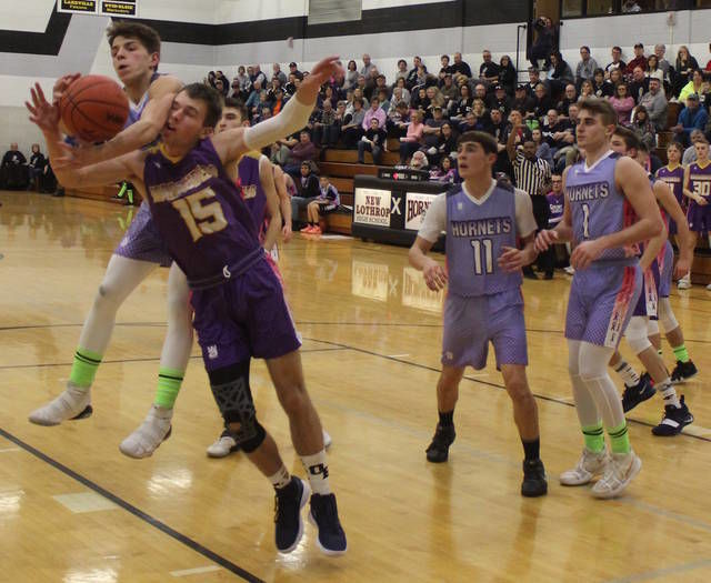 BOYS BASKETBALL: O-E beats New Lothrop to wrap up outright MMAC title