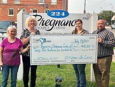 Women's group donates $21,600 to pregnancy center