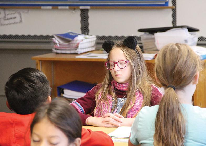 'Being in the moment': Elementary students take time for mindfulness each day