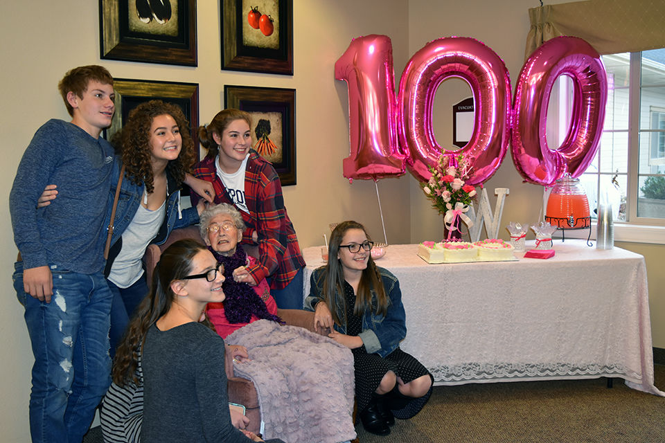 Woman celebrates century of living surrounded by family, friends