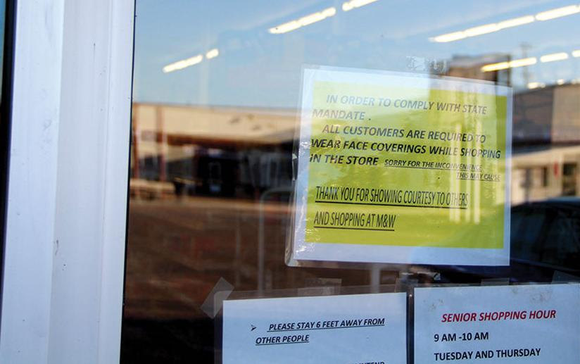 Local businesses put up signs about state's new face-covering rule, some offer free masks